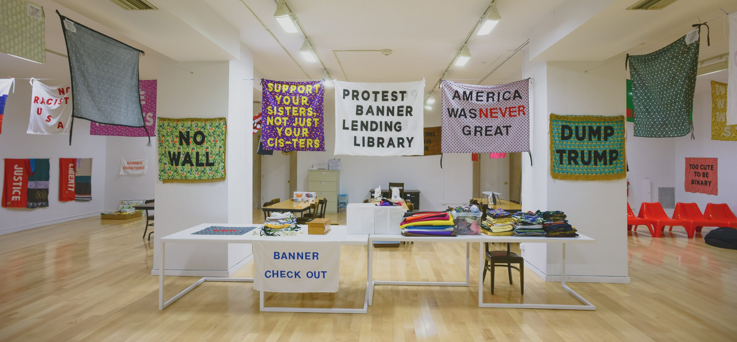 Aram Han Sifuentes, Protest Banner Learning Library Installation at the Chicago Cultural Center, 2017.